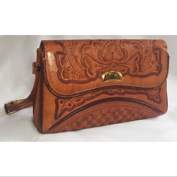 Hand tooled leather cross body bag Mexican floral.  M 5a5a4bfb84b5ce60a05c483b 9b5c712ce5517